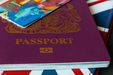 close up of British passport with credit card