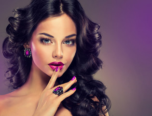 Model curly hair and jewelry,violet makeup,manicure and nails