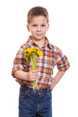 Little boy with bunch of dandelions