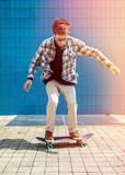 Skateboarder jumping in city