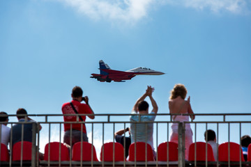 Fighter aircraft and spectators in the stands