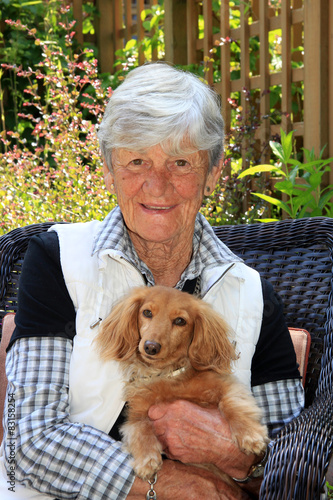 Senior lady and her dog. Poster