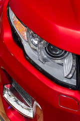 Headlight with led lamps and hood of red sport modern car