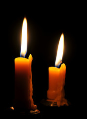 Two candles burning brightly.