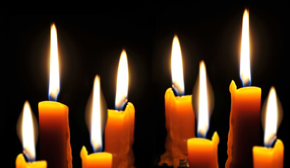 Several candles burning brightly