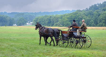 Unrecognizable Farmers returning from the Amish organic's market