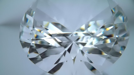 Facets of a diamond sparkle the bright light