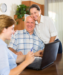 Happy mature couple  with social worker