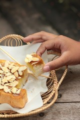 Toast topped with almonds and honey.