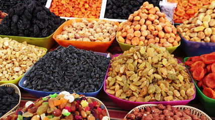 Assortment of dried fruits and nuts at a market