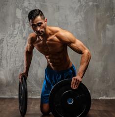 Muscular guy in blue shorts