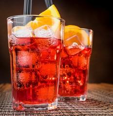 spritz aperitif aperol cocktail glasses with orange slices, ice