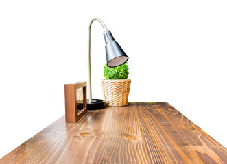 Wood Table top with lamp ,picture frame and green bush in wicker