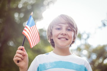 Young boy holding an american flag