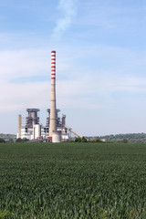 thermal power plant on green wheat field