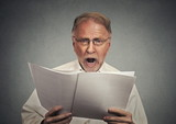 surprised businessman reading documents