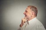happy senior man thinking