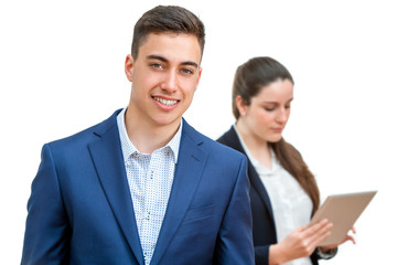 Young businessman with partner in background.