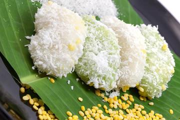 Mung bean rice - crepe on banana leaves and black ceramic