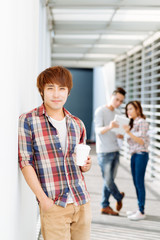 Young man with take-out coffee