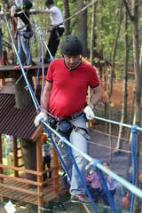 Man climbing in adventure park