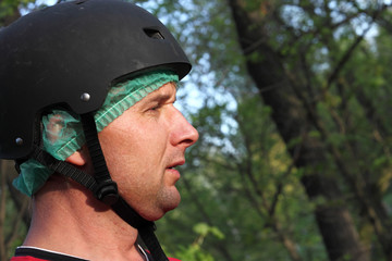Man with helmet in the park