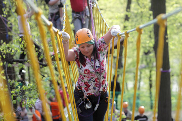 Person at adventure park in forest