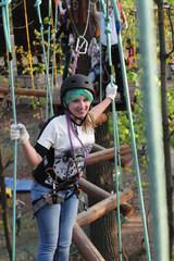 Teen climbing the rope