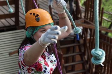 Woman climbing at adventure park