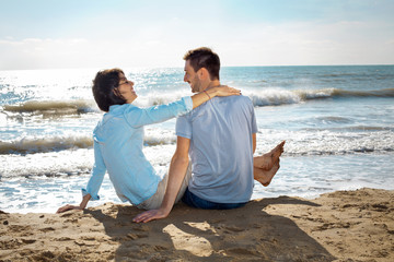 couple in love talking relaxed beachfront