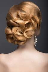 beautiful woman in the image of the bride. Hairstyle back view