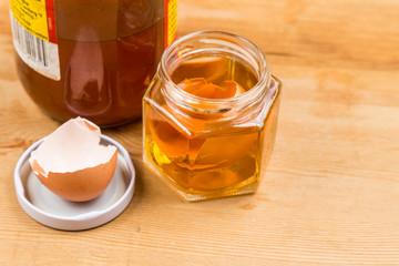 Jar containing apple cider vinegar soaked egg shells
