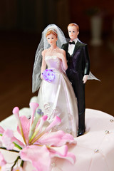 Wedding cake with models of bride and groom