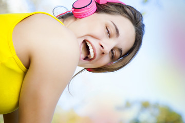 Happy young woman working out outdoors with headphones