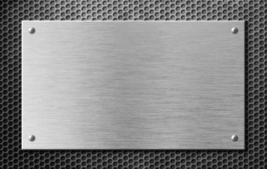 metal plate or signboard with rivets over grid