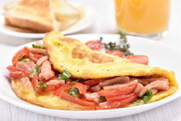 Omelette with vegetables and ham