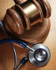 Judge gavel and stetaskop on wooden background