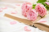 Roses and old book.  - 83199092