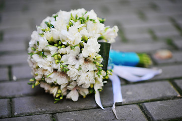 Wedding bouquet on the pavement