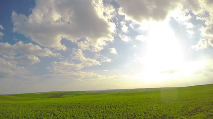 Sun and Clouds over Fields. Timelapse UHD