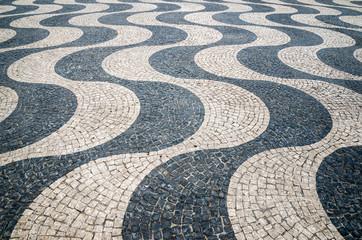 Typical portuguese cobblestone hand-made pavement in Portugal, L