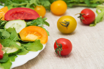 Fresh salad with tomatoes, rucola