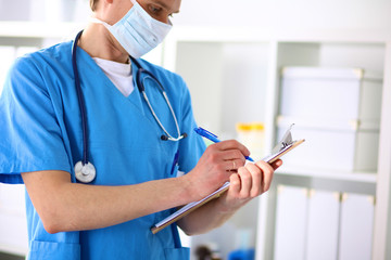 Closeup portrait of a  doctor with stethoscope holding folder