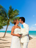 young loving couple on tropical sea background