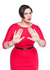 Beautiful plus size woman making stop gesture