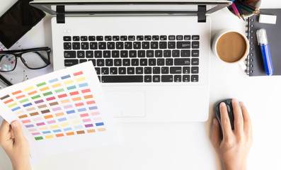 closeup designer use laptop on desk workspace