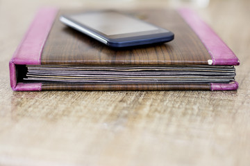 Diary with smartphone mobile on top