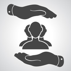 two hands with group of businessman icon on a grey background -