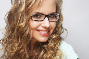 friendly blond woman with glasses