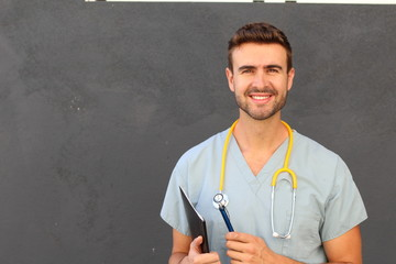 Portrait of young male nurse in scrubs smiling